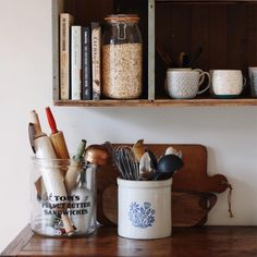 The everyday beauty of cookbooks and kitchen utensils.