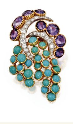 18 KARAT GOLD, PLATINUM, TURQUOISE, AMETHYST AND DIAMOND BROOCH, CARTIER, PARIS, CIRCA 1950  Of foliate design set with cabochon turquoise segments, round amethysts, and round diamonds weighing approximately 1.00 carat, signed Cartier, Paris, numbered 017045, maker's mark, French assay marks.