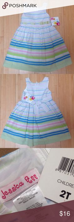 NWT Jessica Ann Sleeveless Striped Dress - 2T Stripes on light green, bright green, blue, pink and white. Green ribbon woven across the bodice with a bow on the side. Sleeveless, zips up the back and has a tie. Polyester/rayon blend. Attached tag reads 2T New with tag Jessica Ann Dresses Casual