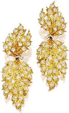 PAIR OF MATCHING PENDENT EAR CLIPS, Gianmaria Buccellati. Pendent ear clips, the diamonds altogether weighing approximately 4.00 carats.