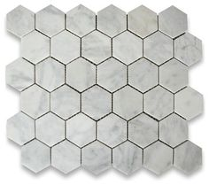 Carrara Marble Hexagon Mosaic Tile 2 inch Honed traditional floor tiles. Another possibility for the fireplace surround.