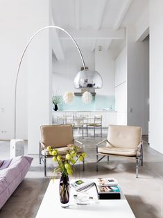 23 ways to decorate with copper living rooms metals and interiors modern pastel living room inspiration featuring the arco floor lamp a bright purple couch and a white coffee table aloadofball