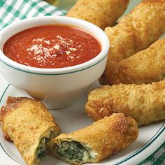 """Italian Egg Rolls These extra-special appetizers were shared by Carolyn Scilanbro from Hampton, Virginia. She writes, """"Everyone loves egg rolls! These are stuffed with sausage and spinach for an unexpected twist. Tailgate Appetizers, Tailgating Recipes, Appetizer Recipes, Italian Appetizers, Football Recipes, Cold Appetizers, Dinner Recipes, Cookbook Recipes, Cooking Recipes"""
