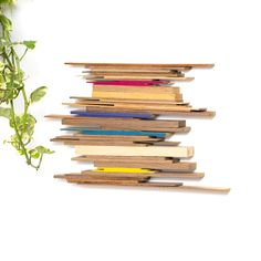 Best 10 A little bit of paint and glue is all that's needed to turn scraps of wood into rainbow wall art! Stick Wall Art, Diy Wall Art, Diy Art, Popsicle Stick Crafts House, Craft Stick Crafts, Wood Wall Decor, Wood Wall Art, Home Crafts, Arts And Crafts