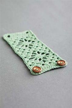 This crochet  cuff makes a fun statement.  Bodega Bay Cuff by Nicole Escude