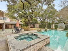 The backyard, bordered by the original rose wall of George Carter Estate, includes a beautiful pool as well as a grill master's dream outdoor kitchen and expansive entertainment area. Small accents, like the Bevolo gas lanterns from New Orleans add to the southern charm and authenticity of the home. There is also a separate open-plan, light-filled guest house with one full bathroom and a modern kitchen, which carries through the Low Country design.