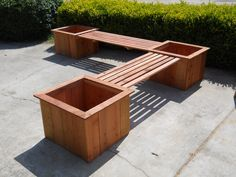 Bench with planter boxes. This would look great around a fire pit!