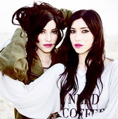 I love twins!!! Here are the Veronicas, they sing together and have some great new music videos out on their band site :D