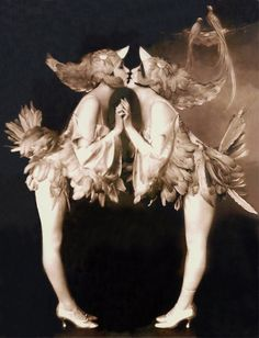 1920s flappers and Ziegfeld Follies the Dolly sisters dressed in feathery costumes and photographed by Alfred Cheney Johnston.