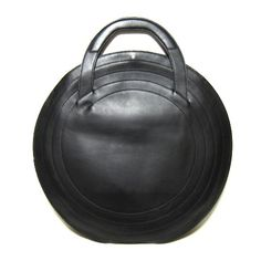 round leather tote a la issey miyake