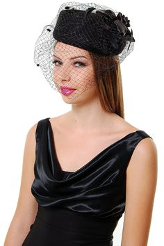 48.00 Step back in time with this amazing felt pill box style hat! This  black 767f011779f