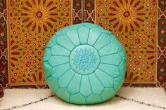 Exquisite hand stitched Moroccan leather pouf made from the finest quality, locally tanned, leather.  Colour: Turquoise  Each piece is handcrafted to the highest standard by our own artisans in the souks of Marrakech.  .:  Size 21in x 13in .: 100% Leather .:  Zip on the Underside .:  Ethically Handmade in Morocco  Check out our full range of colours at: https://www.etsy.com/shop/BerberPoufs?section_id=17630623&ref=shopsection_leftnav_3