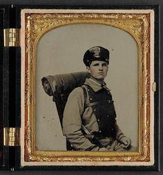 Soldier in Confederate uniform of the 11th Virginia regiment with knapsack and bedroll