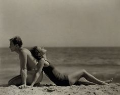 Douglas Fairbanks Jr. and Joan Crawford steeped in romance on a quiet Santa Monica beach. Photographed by Nickolas Muray for the October 1929 issue.