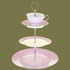 This   beautiful Miss Darcy china cakestand consists of three tiers with a pretty teacup on the top tier. The lovely lavender colour is complimented on each tier with a silver polka dot   design, while the teacup is inlaid with a delicate, vintage inspired silver trim.  Perfect for those tea & cake moments!