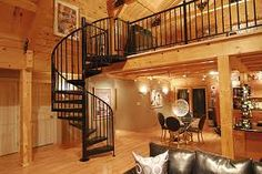 I like the idea of a wrought iron staircase put together next to all the wood