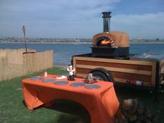 Mobile wood-burning pizza oven. Wheeled, mobile pig cookers are real big here in North Carolina- the tailgate scene needs to be shaken up a little.