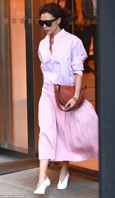Pretty in pink: Victoria Beckham appeared unfazed when she stepped out in New York City on Thursday, opting for a surprisingly colourful ensemble in soft shades of pastel pink