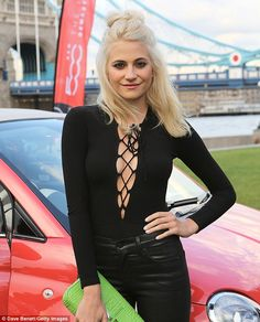 Where's your coat? Pixie Lott flashed the flesh in a very daring top when she attended the...