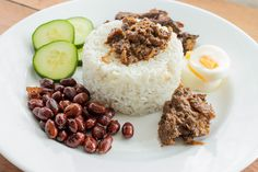 The heart of Nasi Lemak is the rice, made fragrant by pandan leaves and lemongrass, cooked in coconut milk to make it luxurious and flavourful. Malaysian Cuisine, Tamarind Paste, Shrimp Paste, Chilli Paste, Nasi Lemak, Coconut Rice, Cooking For Two, Food Waste, Breakfast Dishes