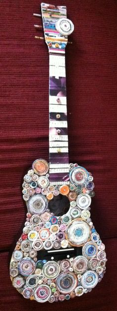 all recycled, child guitar and coiled magazines