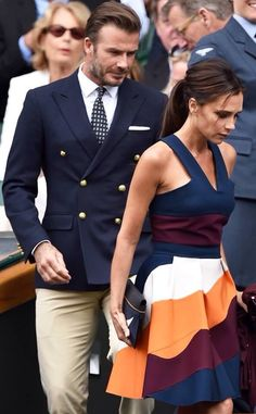 "Victoria and David Beckham. They are leaving Centre Court at Wimbledon for the men's final. They were seated in The Royal Box. (Victoria Beckham is the only Female ""worthy"" of my board). David Und Victoria Beckham, Victoria And David, David Beckham Suit, David Beckham Wimbledon, David Beckham Style, Victoria Style, Victoria Beckham Style, Gentleman Mode, Gentleman Style"