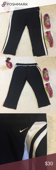 Nike Capri crop pants workout running pants Excellent condition   Black capris with white stripes going down either side both still bright white as photographed  Size  Has drawstring  Feel free to make an offer I have bundle discounts if you want more than one thing from my closet  Tm0165 Nike Pants Capris