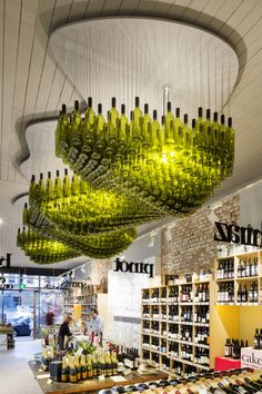 "Wine Republic in Melbourne, Australia installed an lighting sculpture nicknamed the ""Wine Cloud."" The shop design (by Red Design Group) was shortlisted for the Australian Interior Design Awards. Australian Interior Design, Interior Design Awards, Retail Interior, Wine Shop Interior, Lighted Wine Bottles, Bottle Lights, Wine Bottle Chandelier, Empty Bottles, Wine Bottle Lighting"