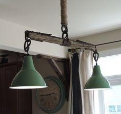 Antique Yoke turned rustic chandelier. A beautiful blend of rustic farmhouse charm with an Industrial twist. Vintage-Inspired mint green barn