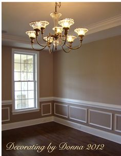 two tone dining room with chair rail - light color above/dark