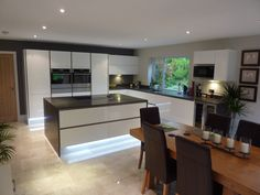 A self-designed kitchen, dining and living space in Wick, Worcestershire, uses two colours from our Supernatural Collection - Piatra Grey 5003 and Frosty Carrina 5141.