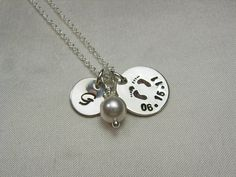 Celebrate Baby: Stamped Date & Footprints, Initial Charm and Swarovski Birthstone Necklace. $32.00, via Etsy.