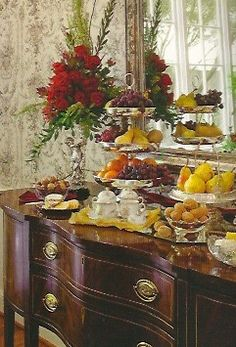 Christmas buffet-serve fruit on pedestal plates, nuts and cheese for pretty and simple presentation
