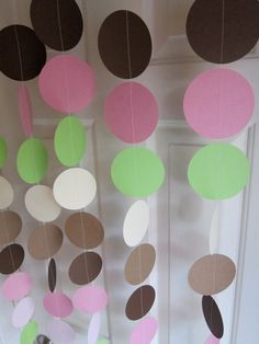 Paper Garland, Brown, Pink, Ivory, and Lime Circles Dangling Decorations, Baby Shower Decorations, Birthday, Wedding, Showers. $22.00, via Etsy.