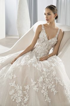 V-neck ball gown with shimmering lace appliques and sheer straps. #DemetriosBride Style 640.