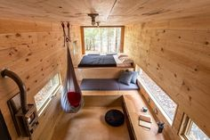This tiny house is a cabin in the woods with cozy wood decore and versatile sleeping areas. Tiny Houses For Rent, Tiny House On Wheels, Little Houses, Mini Cabins, Getaway Cabins, Tiny House Living, Tiny House Design, Bungalows, House In The Woods