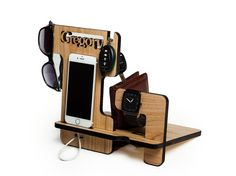 This personalized Combined Docking Station with the ability to install Iwatch charging device. It made of solid wood Ash. Colour - natural or ebony. This gift will please any man. An excellent opportunity to make a gift to a birthday or anniversary. This wooden holder suitable for iPhone 6, iPhone 6s, 6s Plus. Dimensions: Height 9.3 inches Width 12 inches Depth of 7.2 inches Thickness 0.36 inches For the iPhone 6, iphone 6S plus, iPhone 5s and iphone SE in my store also has such a model…