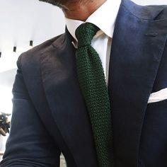 Navy jacket, white shirt, green knit tie