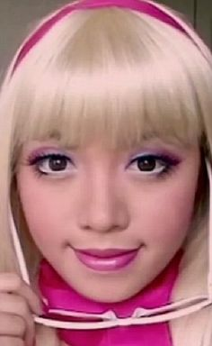 The Barbie Look. It's interesting to see the difference between the The American White Teenage Girl trying to look like an Asian Anime Character and then this one- An Asian Teenage girl transforming herself into an American Barbi doll.