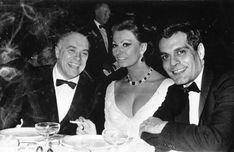 Full of life: Sophia, her husband Carlo (left) and Omar Sharif at a party in New York...