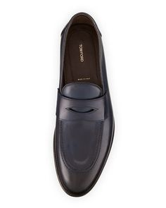 Tom Ford smooth calfskin loafer. Piped trim at collar and vamp. Penny saver…