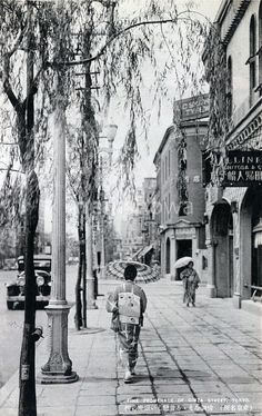 Ginza, Tokyo, Japan in the 1920's, with its still famous willow trees.