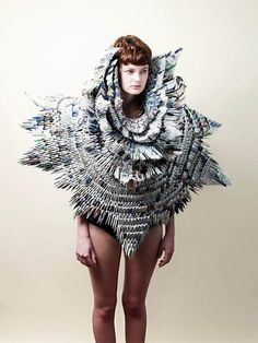 """""""At a World Wildlife Fund charity event in London, textile based sculptor Rowan Mersh showcased a dress he made out of old WWF magazines, using a traditional origami technique. The wearable sculpture was designed in aid of the fundraising event to protect wildlife and habitats, tackle climate change, and promote sustainable ways of living."""""""