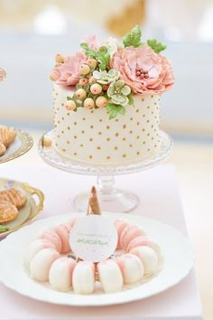 So cute! Polka dot cake with flowers on top with adorable little macaroons