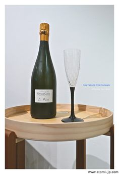 Tray table with champagne flute from atomi .. all available for sale, including the champagne!