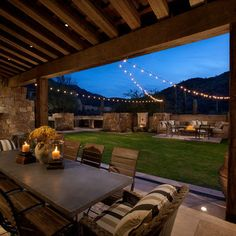 High Quality Outdoor Patio String Lights Attached To An Arboru0027s Rafters While The Fire  Pit Offers Additional Light. Now THIS Is Entertaining!