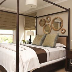 mirrors above bed