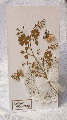 "By Viv. Die cut Bella Bouquet"" (Memory Box) and butterflies Add doily, bow, and sentiment on white linen cardstock base."