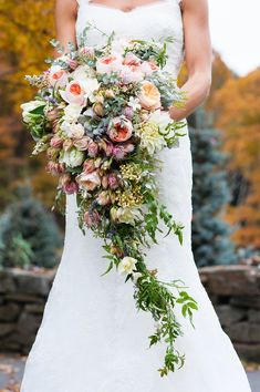 Rustic Fall Woodstock Inn Wedding || Cascading Bouquet || See more on the #LBBBlog: http://www.StyleMePretty.com/little-black-book-blog/2014/02/11/rustic-fall-woodstock-inn-wedding/