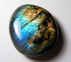 Labradorite - used for expansion, sensory awareness, and protection against negativity  Special note: Labradorescence is the deep blue sheen that appears when the stone is held to the light.  Other stones can be said to have Labradorescence qualities to them as well.